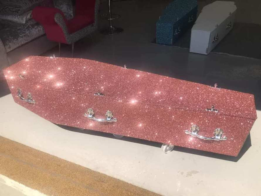 pink sparkly coffin covered in glitter