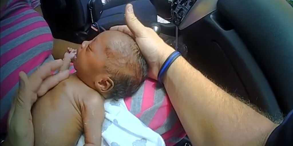 Deputy trying to save the baby.