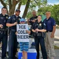 An 11-year-old's clever 'ice cold beer' sign prompts a visit from the police