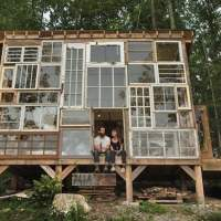 Couple repurpose old windows by using them to build a unique 'glass cabin' in the forest
