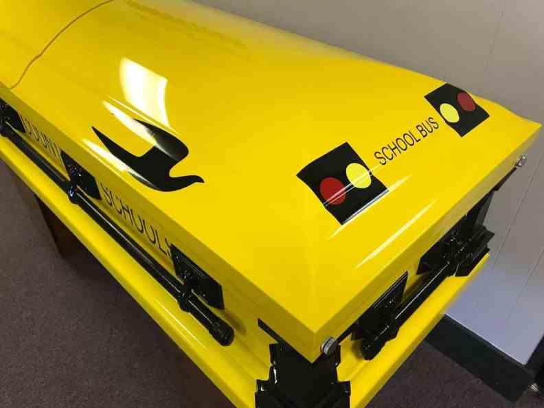 school bus themed casket
