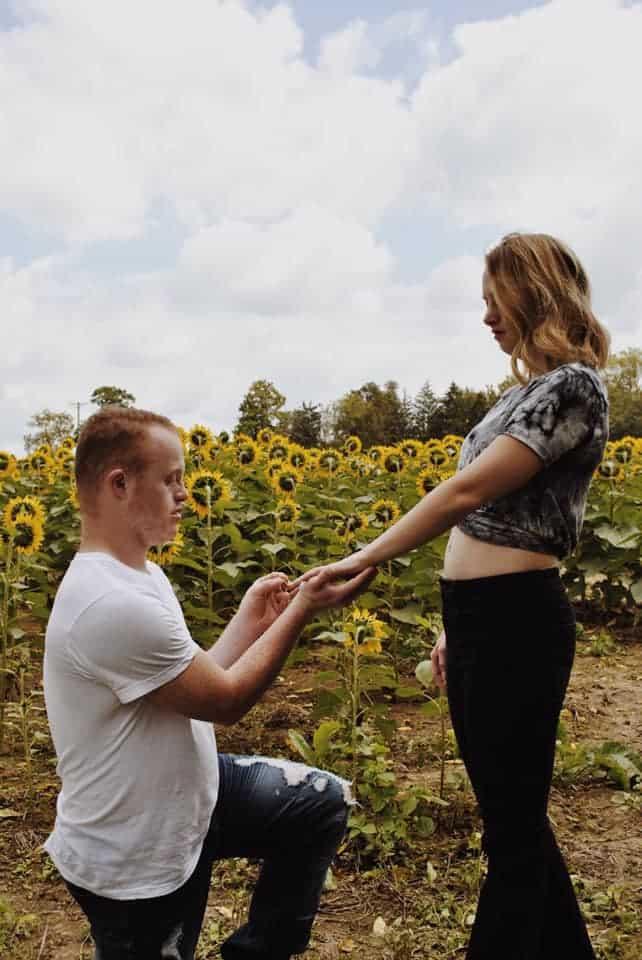 couple in sunflower field
