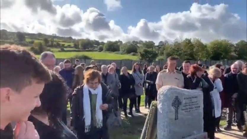 Mourners gathered at Bradley's funeral.