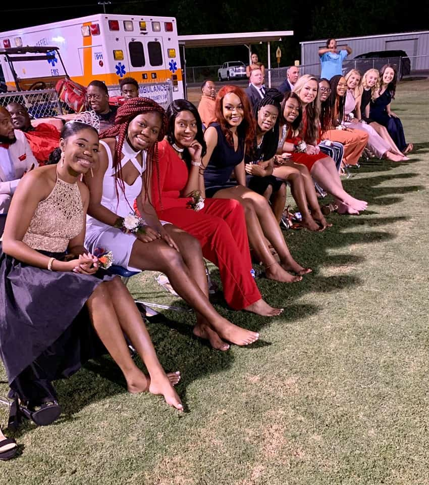 Homecoming queen candidates walk barefoot in support of a fellow aspirant with epilepsy.