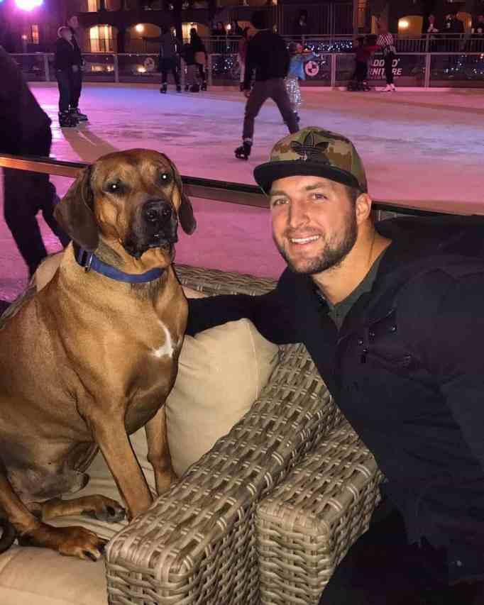 Tim Tebow with beloved dog, Bronco.
