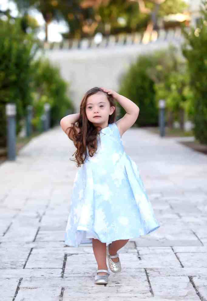 Watch out Devon Aoki and Cara Delivigne there is a new supermodel in town! A smiling toddler with Down syndrome is conquering the fashion world.