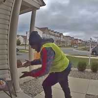 Delivery driver dances out of joy because a family left goodies for him on their porch