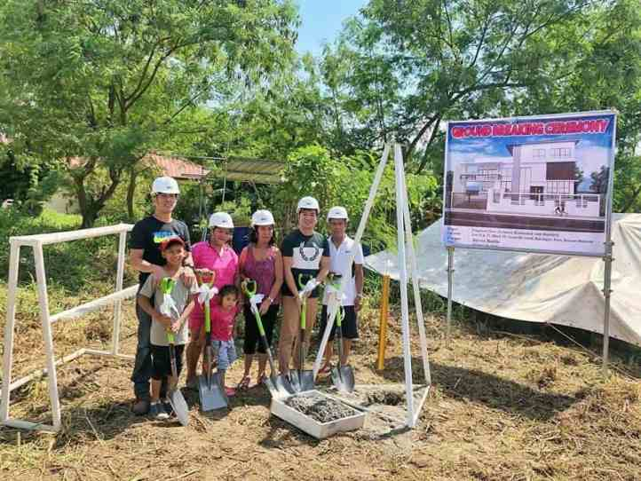 Jayvee with his family at the start of the construction of their new house.