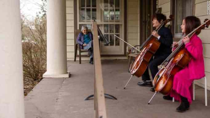 Siblings playing their cello instrument