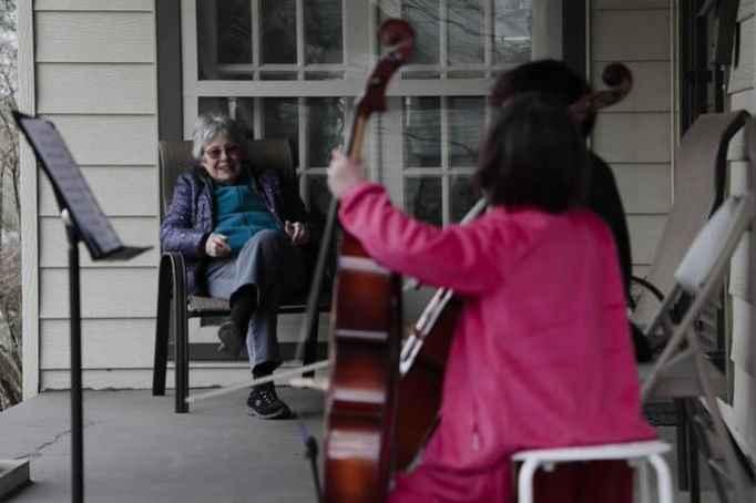 Little girl holding her cello instrument