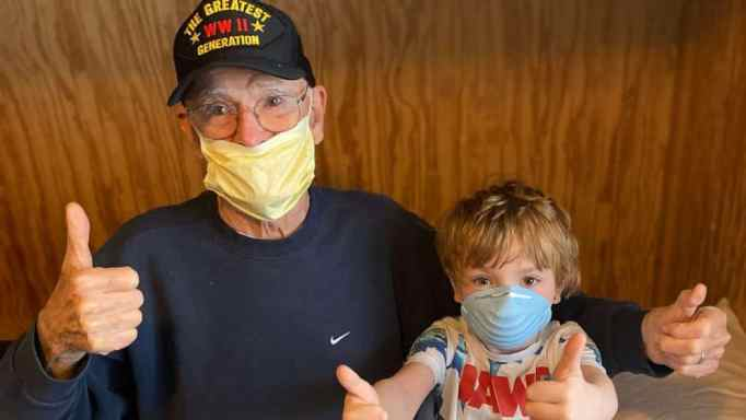 WWII veteran Bill Kelly with his great-grandson