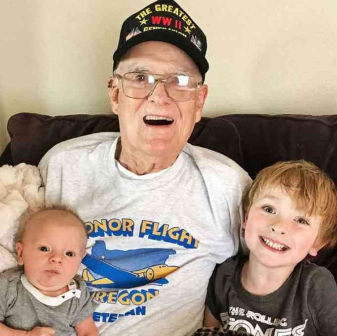 WWII veteran Bill Kelly with great-grandchildren