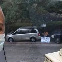Husband holds sign outside to show support for wife who has to go to chemotherapy alone