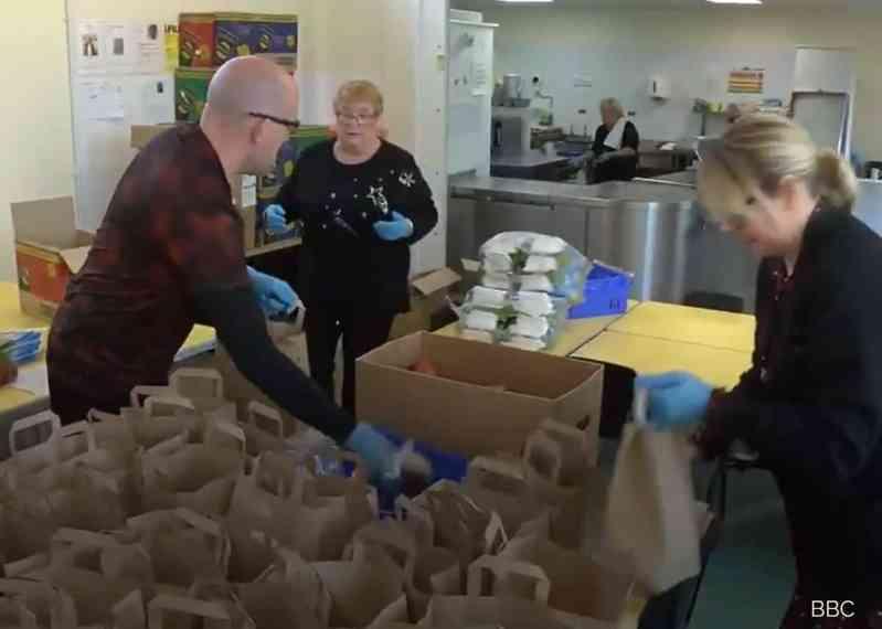 Kitchen staff helping the teacher.