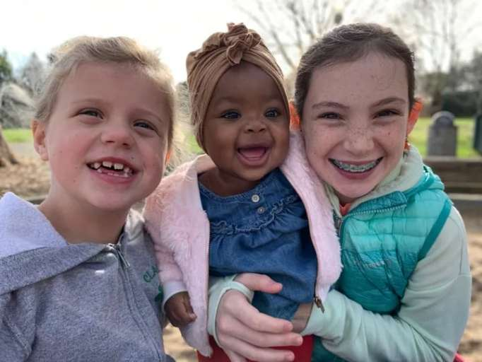 The new Gerber baby with two girls.
