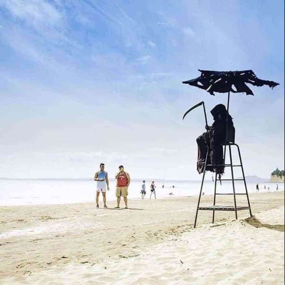 The grim reaper attorney watches over beach goers.