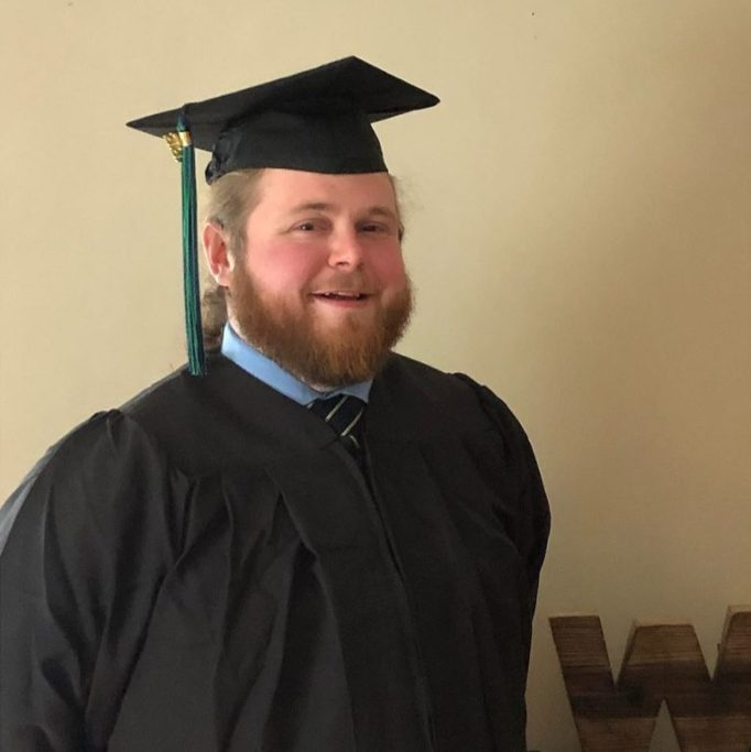 Clayton Ward earns his college degree after being an undergraduate.