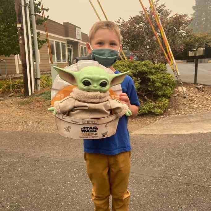 Carver holding Baby Yoda