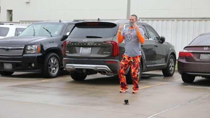 Chuck Yielding dancing in a parking lot
