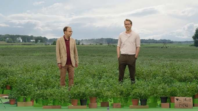 Rick Moranis and Ryan Reynolds standing in a mint field