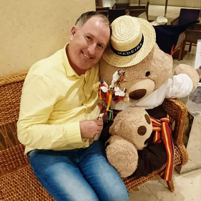 Edmund O'Leary hugging a teddy bear