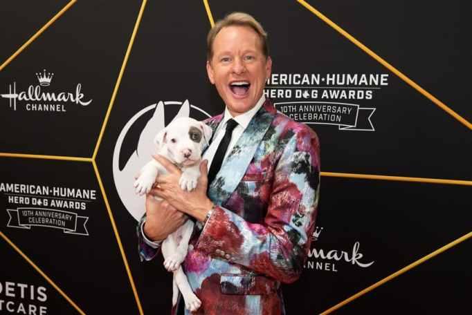 Carson Kressley holding a dog
