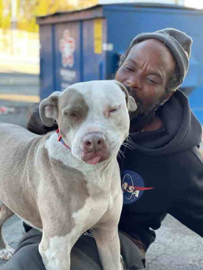Keith Walker with one of the dogs he rescued