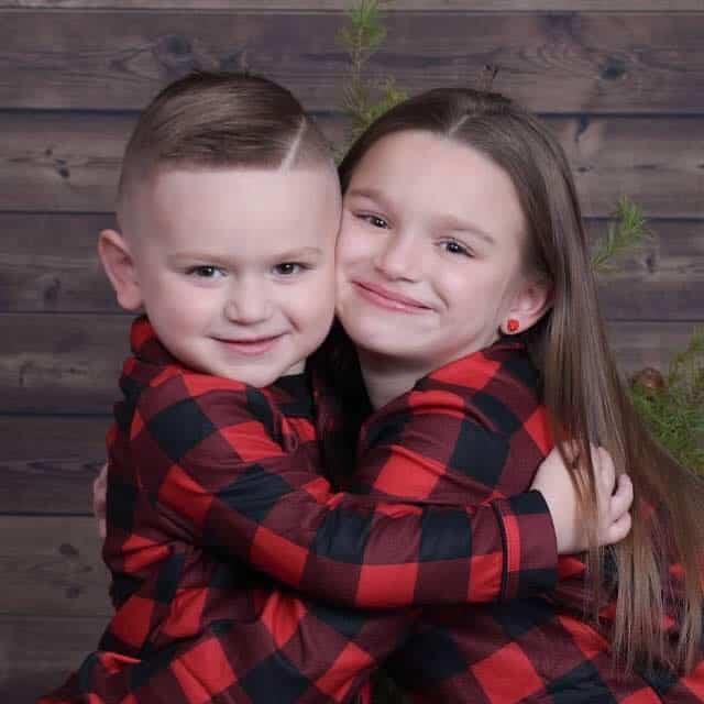 Siblings Olivia Heid and RJ Heid hugging