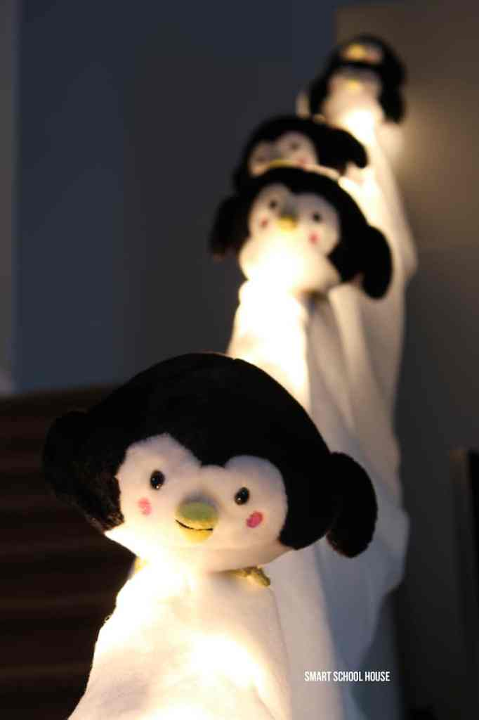 Snowy penguin slide Christmas decoration