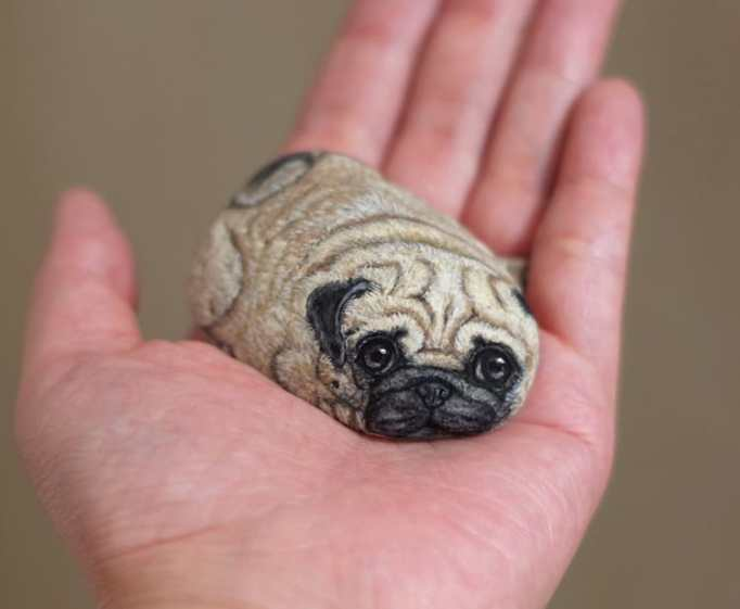 An image of a pug painted on a stone by Akie Nakata