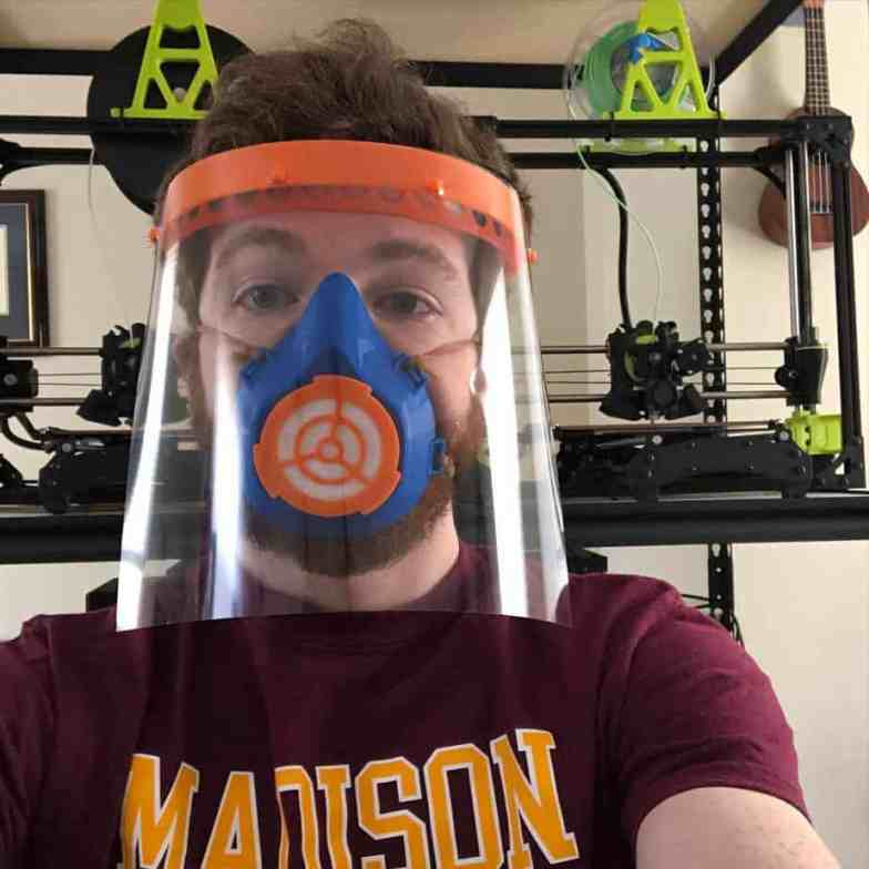 Jason Erdreich, the teacher wearing his 3D-printed face shield and face mask.