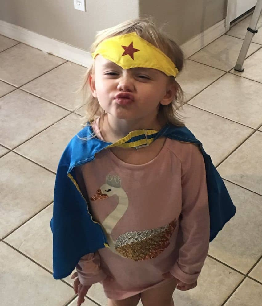 Kaila Zach in her Wonder Woman costume giving the camera a playful kiss.
