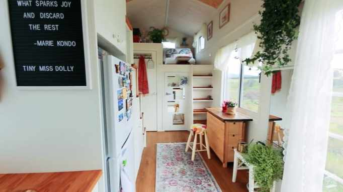 Tiny house with a walk-in closet has beautiful interior designs.