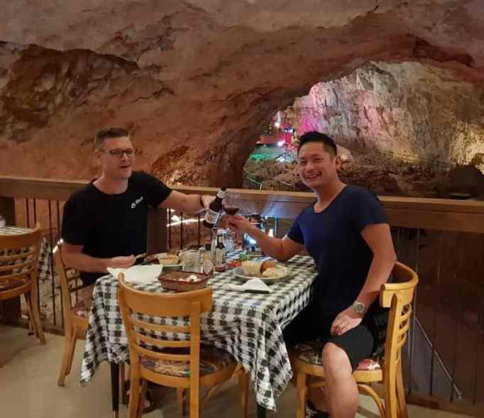 Visitors enjoying their unique dining experience underground.