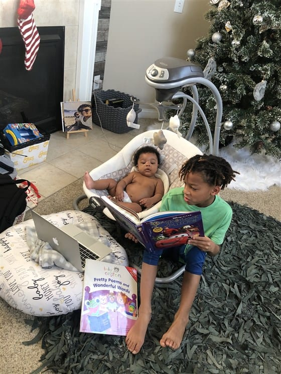 Mason reading a story to his little brother