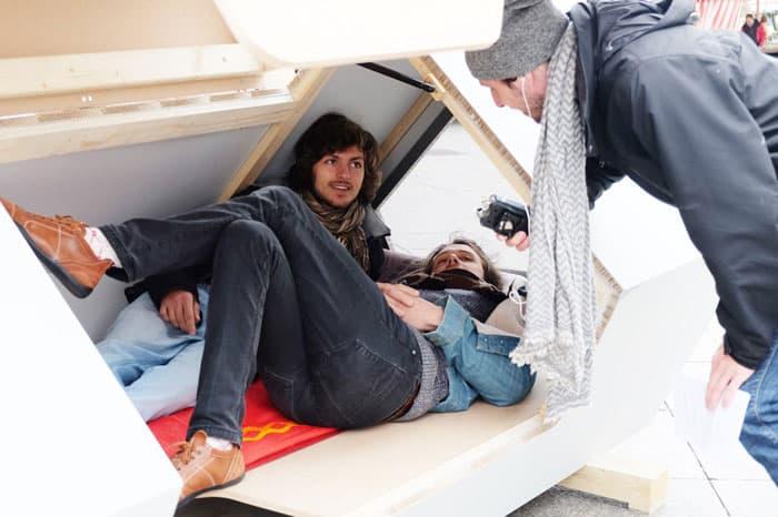 Two men inside an Ulmer Nest