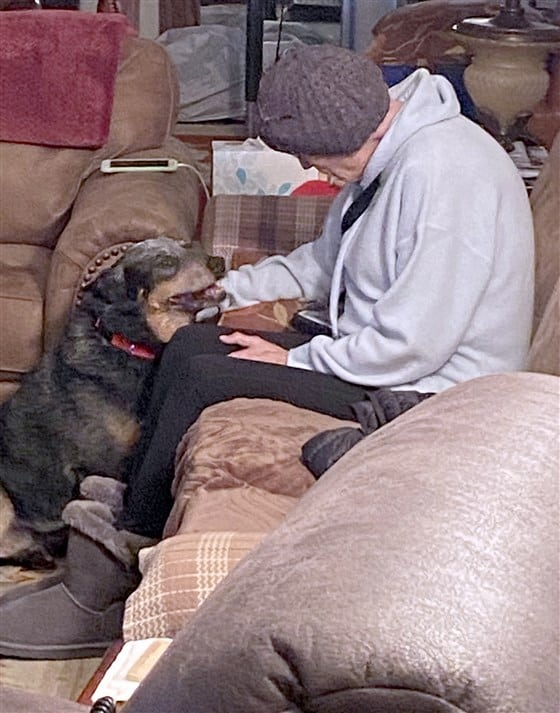 A woman battling cancer petting her new dog