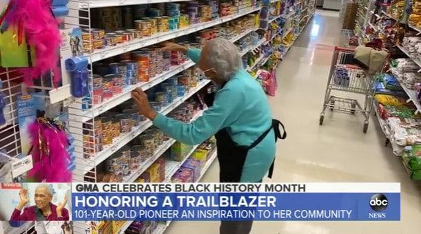 Romay Davis stocking shelves at Winn-Dixie