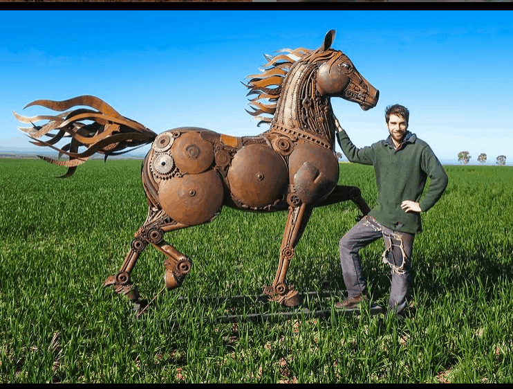 Jordan Sprigg and one of his magnificent metal sculptures made from recycled metals