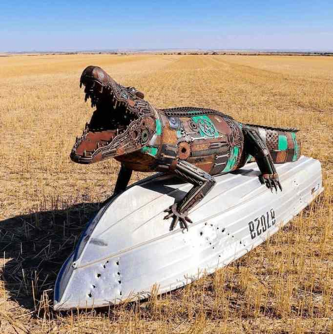 A terrifying sculpture of a crocodile, created by the talented metal artist Jordan Sprigg