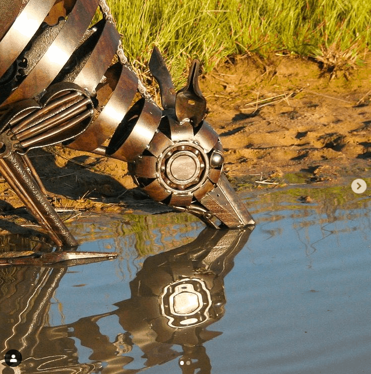 A life-like metal sculpture, quenching his thirst for water
