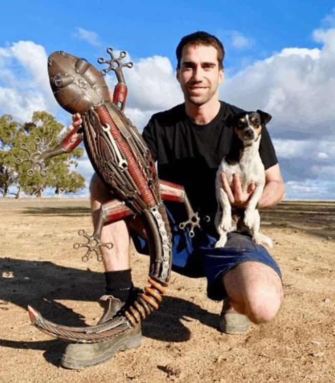 Jordan, his dog, and a gecko sculpture he made