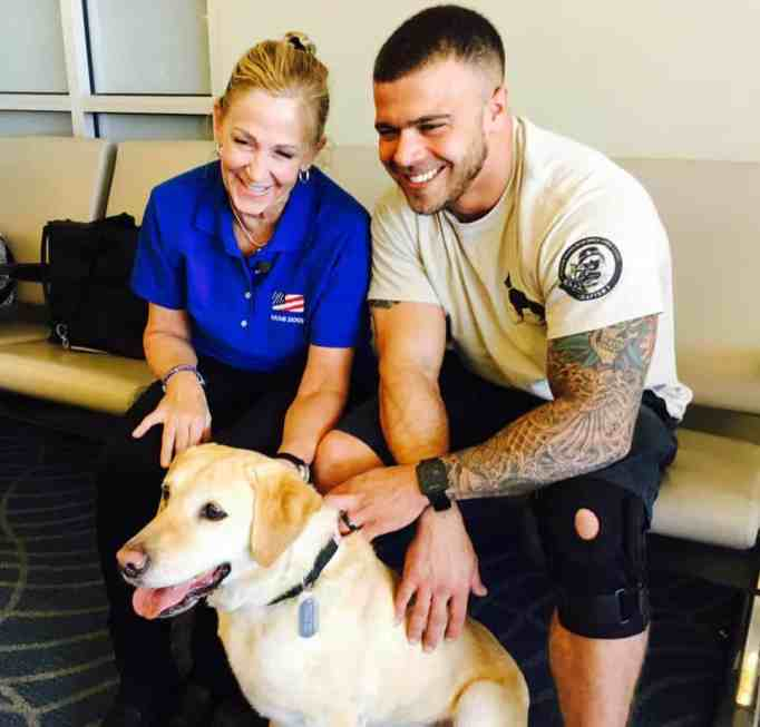 Mollie Oliver, Sgt. Tom Hansen, and Taylor at Boise Airport