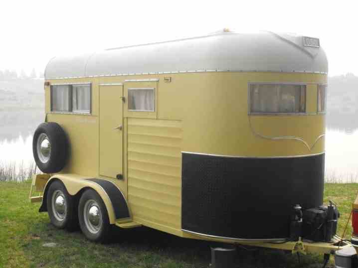A canary yellow camper trailer made by Fred Cote