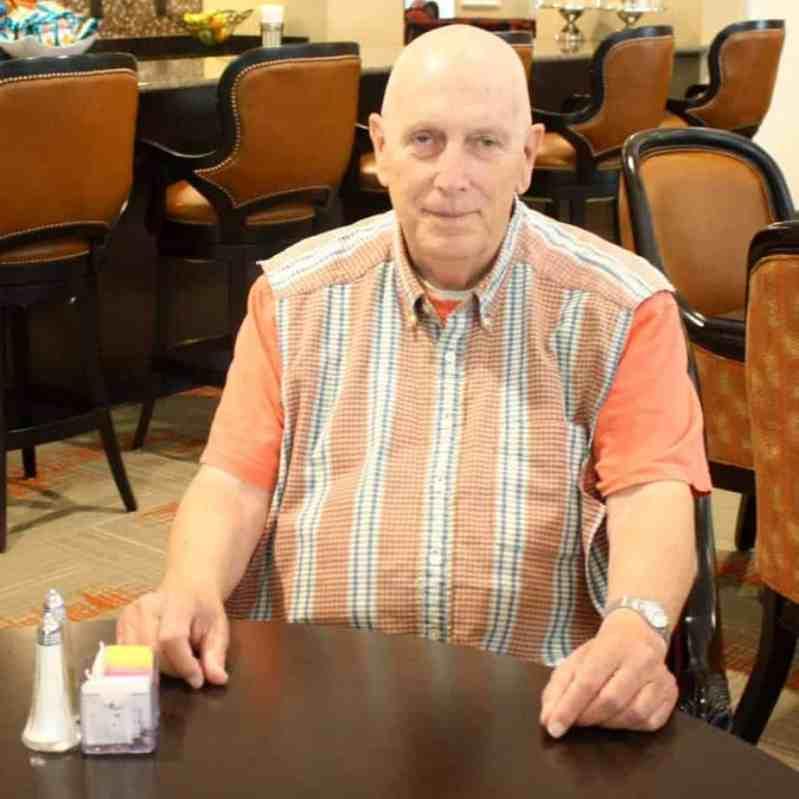 A man wearing a dignity bib