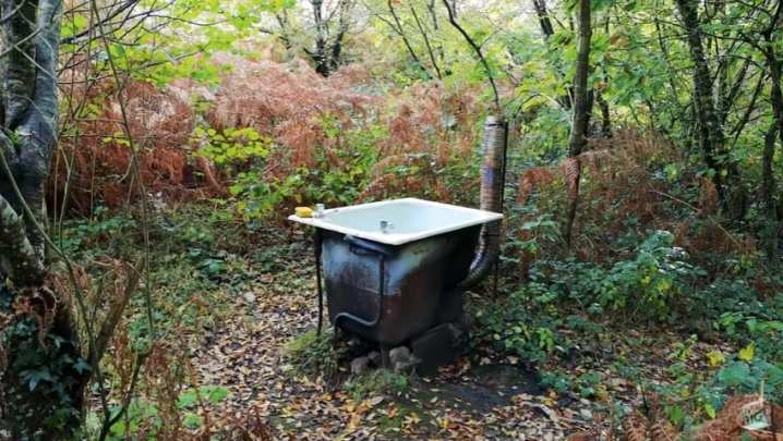 A makeshift bath within the woods