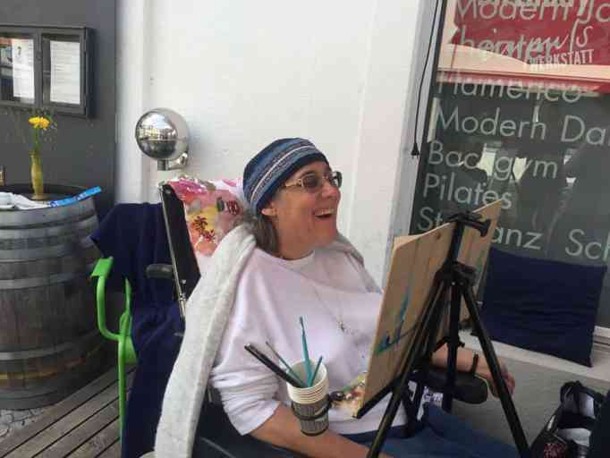 Bracha Fischel with an easel in front of her
