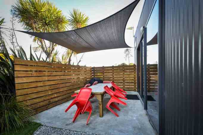 A private outdoor area with a table and chairs