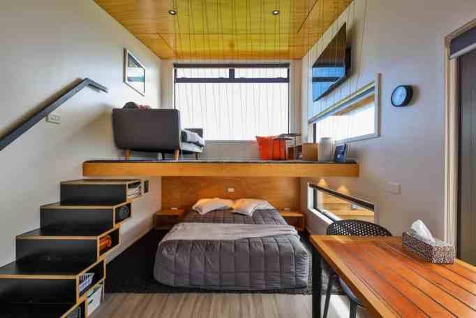 The loft area and sleeping area inside a tiny home