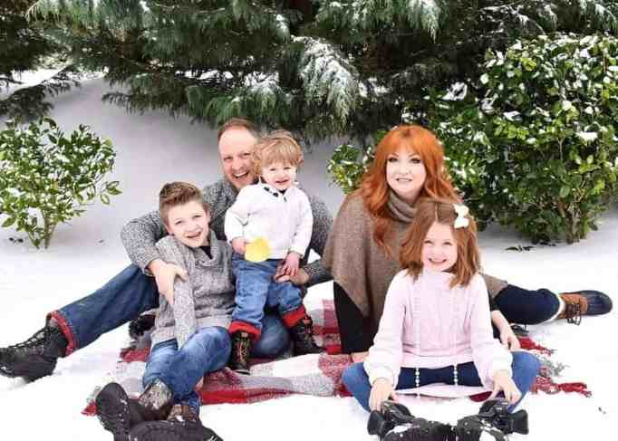 The Jones family posing for a photo on the snow